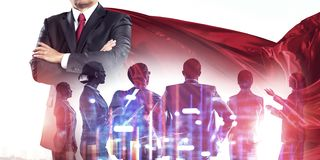 Building his super team. Superhero leader and his successful business team royalty free stock images