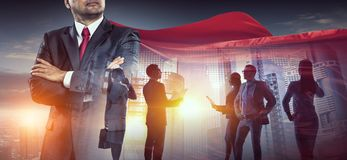 Building his super team. Superhero leader and his successful business team royalty free stock photo