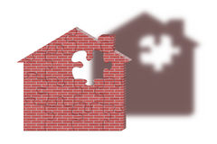 Building a home. A house made of bricks and puzzle pieces Royalty Free Stock Images
