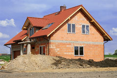 Building_a_house. House of brick - building a new house stock image