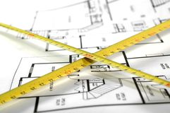 Building a House. House plans and folding rule , concept of home architecture Stock Photo