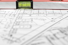 Building A House. Water level and architectural plan , home building concept Royalty Free Stock Image