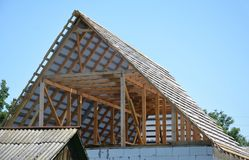 Building house attic roof construction with trusses, wooden beams, waterproofing memmbrane. Building house attic roof construction with trusses, wooden beamsn royalty free stock images