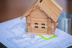 Building house on blueprints with worker - construction project.  royalty free stock photo