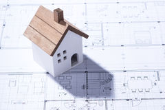 Building house on blueprints with worker - construction project.  royalty free stock photography