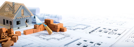 Building house - bricks and project. For construction industry royalty free stock photo