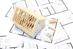 Building house concept. Building the house concept - model of the house with building material and blueprints, top view Royalty Free Stock Photos