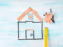 Building house concept flat lay with and wood Royalty Free Stock Photo