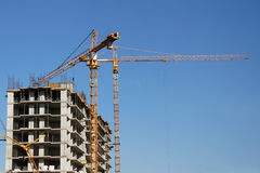 Building house and construction crane Stock Photos