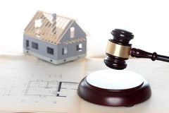 Building a house with law symbol Royalty Free Stock Photo