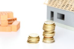Building a house with money Stock Photos