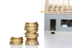 Building a house with money stacks Stock Photos