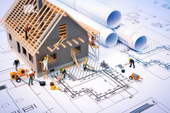 Free Building House On Blueprints With Worker Royalty Free Stock Image - 53359756