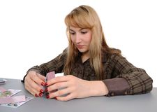 Building house from playing cards Stock Images
