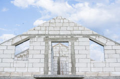 Building a house of white bricks Stock Image