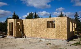 Building a house of wood blocks Stock Photos