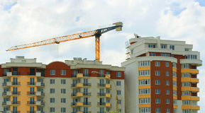 Building houses. Construction of tall houses, the construction crane stock images
