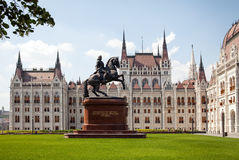 The building of the Hungarian parliament. Front view left wing. Statue of rider on horseback. The building of the Hungarian parliament. Front view left wing Royalty Free Stock Images