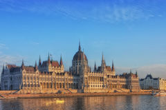 Building of Hungarian Parliament. Building of the Hungarian Parliament  in neo-gothic style on the banks of the Danube. Bright blue sky completesrcomposition Royalty Free Stock Image