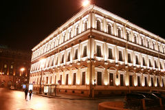 Building with illumination. A building with illumination in the street at night Stock Photos