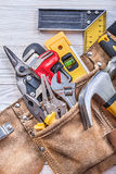 Building implements in toolbelt on wooden board construction con. Cept Stock Photography