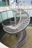 Building indoor of metal spiral staircase Royalty Free Stock Images