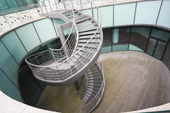Building indoor of metal spiral staircase Stock Photos