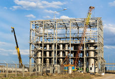 Building at industrial plant. Construction of the industrial building against the cloudy sky Royalty Free Stock Photography