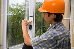Building inspector. The building inspector checks quality of installation of new windows Stock Photography