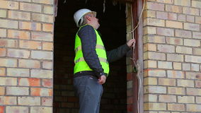 Building inspector checking damaged wiring stock video footage