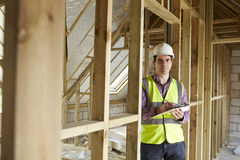 Building Inspector Looking At New Property Royalty Free Stock Images