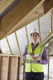 Building Inspector Looking At New Property Stock Photos