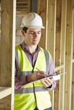 Building Inspector Looking At New Property Stock Photography