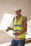 Building Inspector Looking At New Property Royalty Free Stock Image