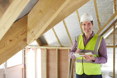 Building Inspector Looking At Roof Of New Property Stock Photography