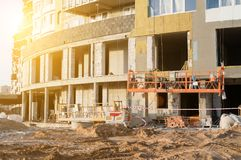 Building insulation thermal exterior. Thermal exterior insulation of an unfinished building in rays of the sun stock photos