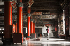 Building interior of temple with one Asian prayer Stock Images