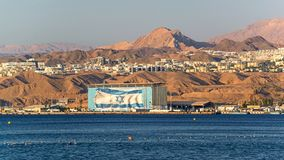 Building with Israel flag on the wall. On the Red sea shore just above the famous flag of Jordan stock images
