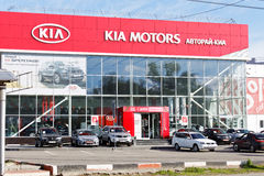 Building of KIA MOTORS car selling and service center with KIA sign. Stock Photo