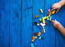 Building kids blocks on blue background
