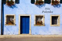 Building in Kobarid. Kobarid, Slovenia - August 14, 2015:Beautiful doors in a building in Kobarid, Slovenija, in the Littoral region Stock Photography