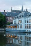 Building on a lake at dusk royalty free stock photography