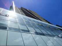 Building with large glass windows. Under a deep blue sky Stock Images