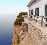 The building of the lighthouse on the cliff at Cape Formentor. Majorca, Spain. Royalty Free Stock Image