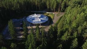 Building like UFO in a forest. Aerial stock video