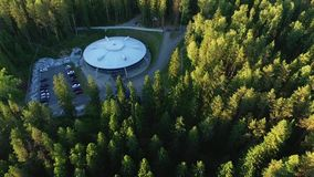 Building like UFO in a forest stock footage