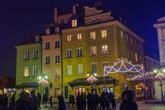 WARSAW, POLAND - JANUARY 01, 2016: Pelikan`s tenement house at New year`s night. Stock Images