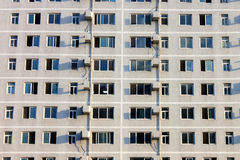 Building with a lot of crowded window Royalty Free Stock Photos