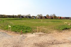 Building lot site with grass after stakeout measurement survey ready for construction, Germany Royalty Free Stock Photography
