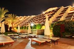 Building of the luxury hotel in night illumination Stock Photos